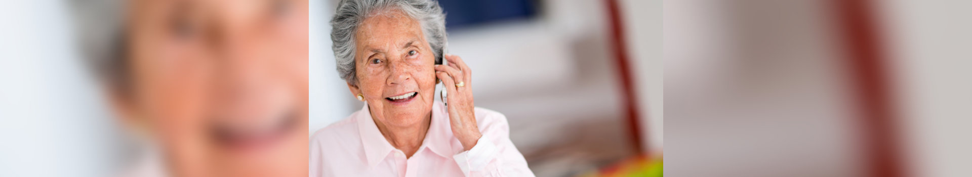 old woman calling someone using her mobile phone